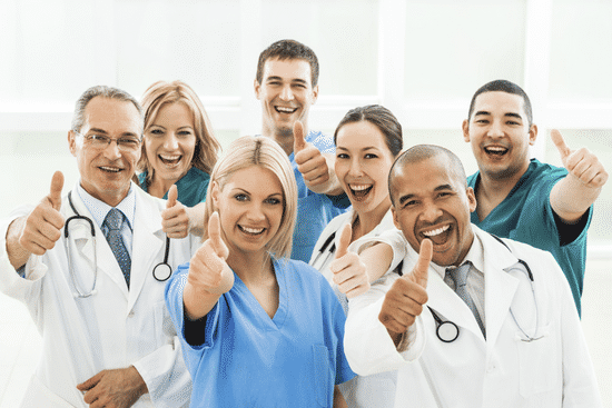 A group of happy doctors with thumbs up